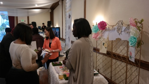 Adaria Designs Team chatting with clients at The Reef Open House